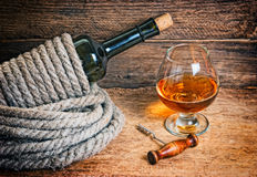Bottle of wine wrapped with rope Royalty Free Stock Image