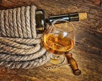 Bottle of wine wrapped with rope Royalty Free Stock Photos