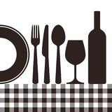Bottle, wineglass, plate, knife, fork, spoon and tablecloth patt. Ern  on white background Stock Photos