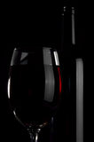 Bottle and wineglass. Royalty Free Stock Image