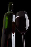 Bottle and wineglass. Stock Photos