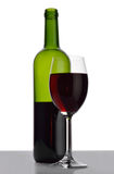 Bottle and wineglass with red wine. Royalty Free Stock Photos