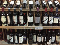Bottle of wines selling at store Stock Photos
