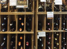 Bottle of wines at shelves selling Stock Image