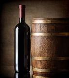 Bottle and wooden barrel Royalty Free Stock Photo