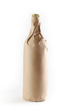 Bottle wrapped in paper bag Stock Photos