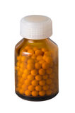 Bottle with yellow tablets Royalty Free Stock Photo