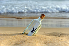 Bottle with yen sign on the sand of the beach, money concept. Bottle found on the beach with a yen symbol inside Royalty Free Stock Photos