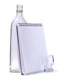 Bottleand-blocknote Stockbild