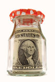 Bottled banknote. There is a saved banknote in a bottle. The background is white Stock Photography