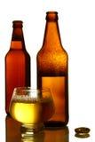 Bottled beer. Golden beer bottles on a white background Stock Photo