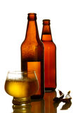 Bottled beer. Golden beer bottles on a white background Royalty Free Stock Photos