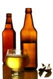 Bottled beer. Golden beer bottles on a white background Royalty Free Stock Images