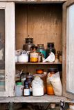 Bottled chemicals in a cupboard. Old laboratory with some bottled chemicals in a cupboard Stock Image