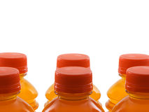 Bottled Drinks. Photo of several orange colored drinks isolated on white Stock Image