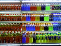 Bottled Fruit Juice and Energy Drinks sold in a Grocery. Photo of bottled fruit juice and energy drinks sold in a grocery store Stock Image
