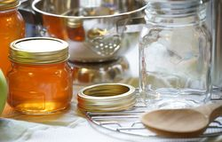 Bottled jam. Of the table of the kitchen royalty free stock photography