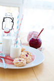 Milk and jam-filled cookies Stock Photo