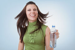 Bottled mineral water and girl Royalty Free Stock Photo