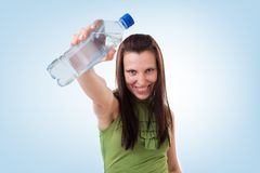 Bottled mineral water and girl Royalty Free Stock Images