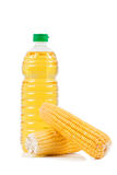 Bottled oil with corns Royalty Free Stock Photos