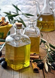 Bottled olive oil. In small glass jars Royalty Free Stock Photography