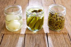 Bottled pickles as capers onion and cucumbers Stock Photography