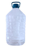 Bottled pure water. Bottled pure water in blue transparent plastic bottle Royalty Free Stock Images