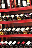 bottled red wines on shelf Royalty Free Stock Images