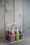 Bottled smoothies with straws Royalty Free Stock Photo