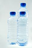 Bottled water. On grey background Stock Image