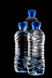 Bottled water. On black background Stock Photo
