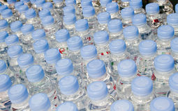 Bottled water. Bottled spring water in the row Stock Photo