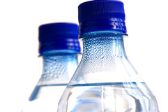 Bottled water. Two Bottled waters on white stock photography