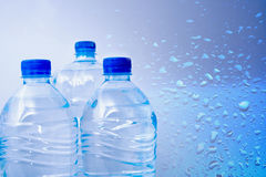 Bottled water. Three pvc plastic bottles of clear water Stock Image