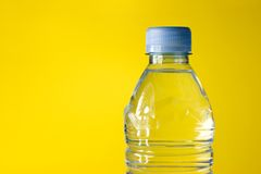 Bottled water. On yellow background Royalty Free Stock Photos