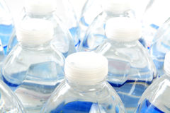 Bottled water. Closeup of the tops of rows of bottled water stock image