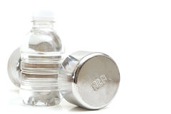 Bottled water fitness weight. Shot of a bottled water with fitness weight Stock Photos