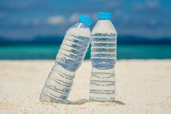 Bottled water on a hot day at the beach Stock Images