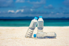 Bottled water on a hot day at the beach Stock Photo
