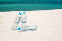 Bottled water on a hot day at the beach Stock Image