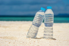 Bottled water on a hot day at the beach Royalty Free Stock Images