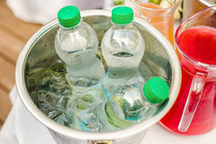 Bottled water in an ice bucket Stock Images