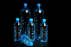 Bottled water isolated over a black background Stock Photo