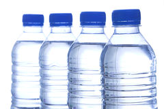 Bottled water in line. Four bottled water in line royalty free stock photography