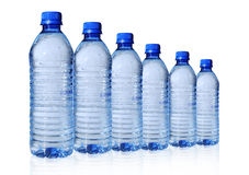 Bottled Water in Six Sizes Royalty Free Stock Image
