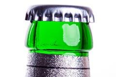 Bottleneck. A green bottleneck of a beer bottle in front of white background Royalty Free Stock Photos