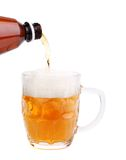 Bottleneck, stream, foam, glass of beer Royalty Free Stock Photo