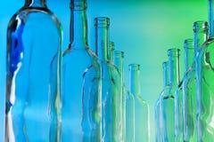 Bottlenecks of glass bottles standing in line Royalty Free Stock Images
