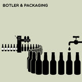 Bottler and packaging of bottles Stock Photo